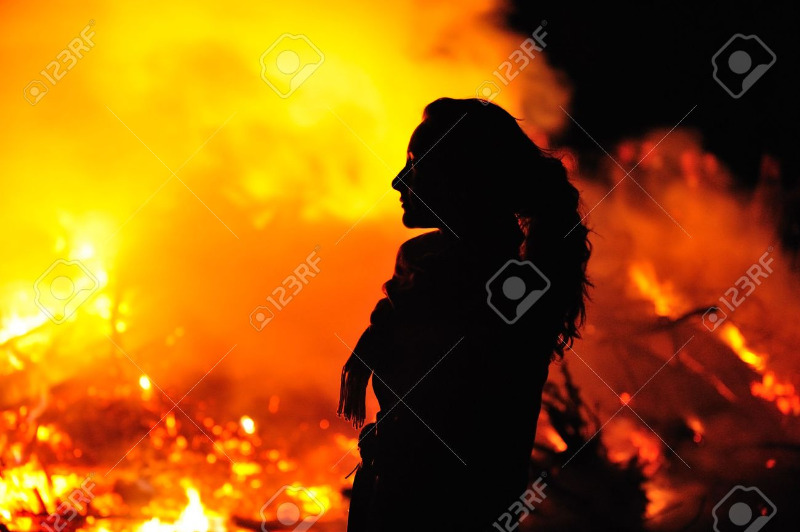 4801543-Silhouette-in-fire-of-beautiful-young-woman-Stock-Photo.jpg